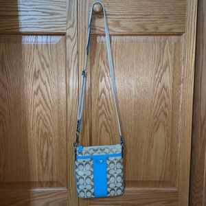 Coach crossbody bag with blue accents